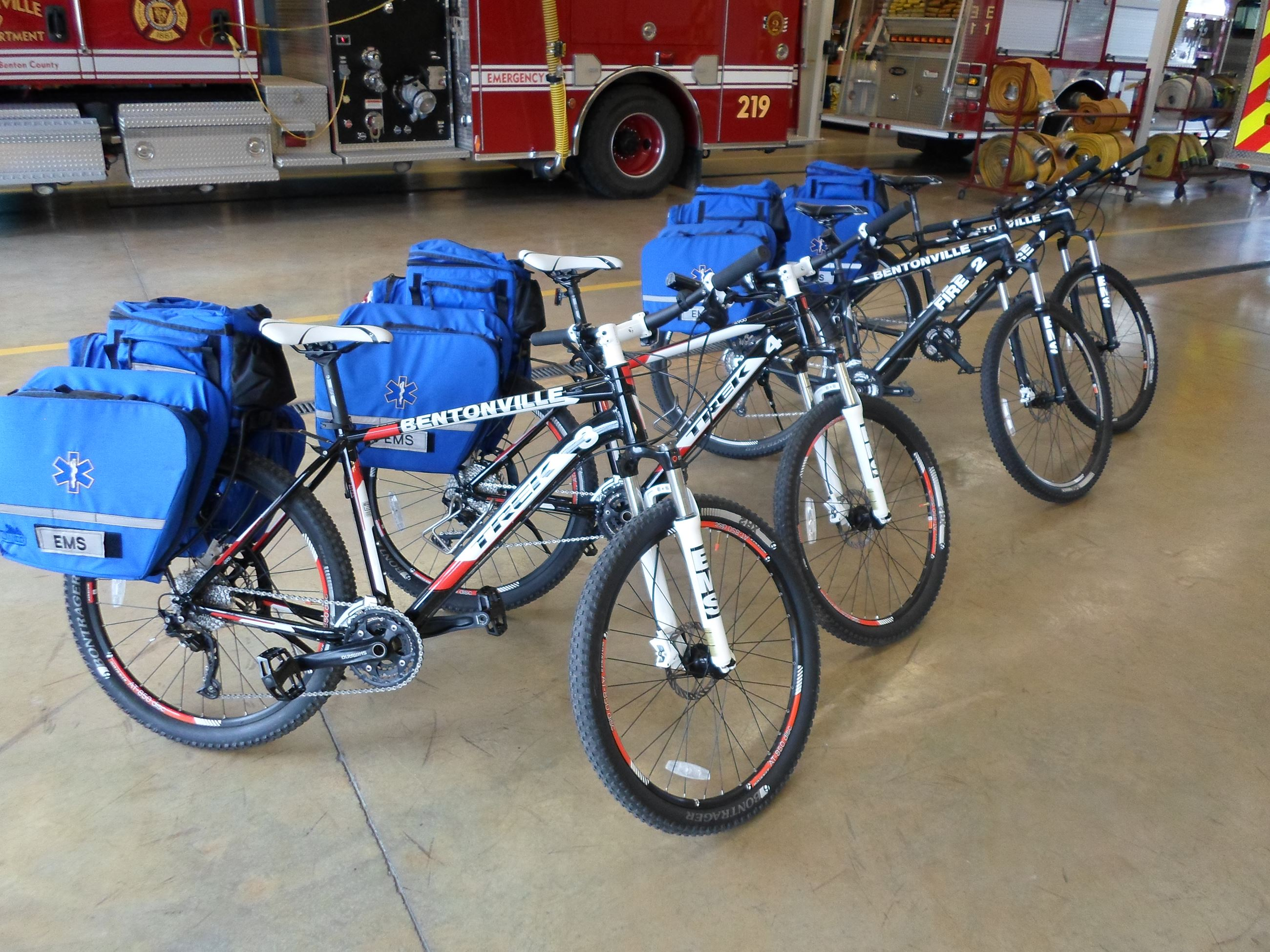 5 EMS Bikes in a row inside station