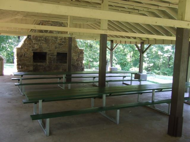 Park Springs Park Pavilion with long picnic tables and two stone fireplaces