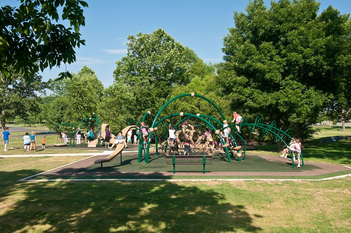 Memorial Park image of children playing on jungle gyms in park