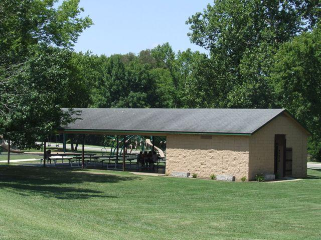 Memorial Park Pavilion stone building with veranda type area with picnic tables