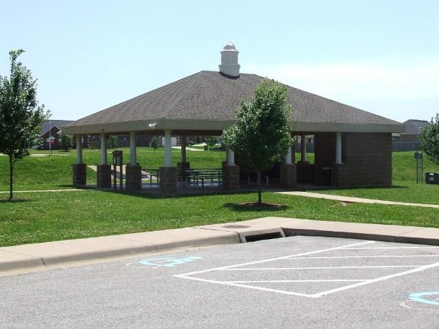 Wildwood Park Pavilion with parking lot and grass and small trees