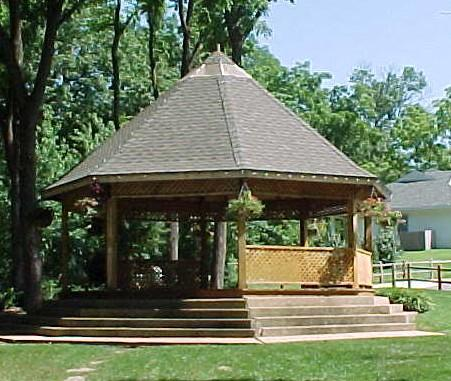 Town Branch Gazebo with stairs and sitting in grass beside trees