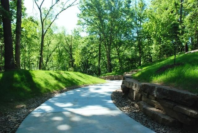 Crystal Bridges Trail paved trail in the woods